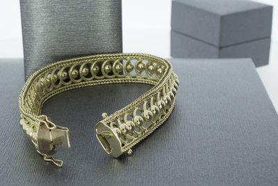 14 karaat geelgouden gevlochten schakelarmband - 20 cm GERESERVEERD