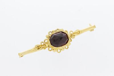 14 Karaat geel gouden Broche gezet met Granaat