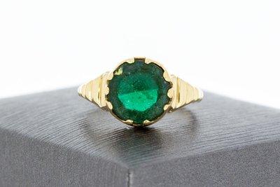 14 Karaat geel gouden ring gezet met groene steen