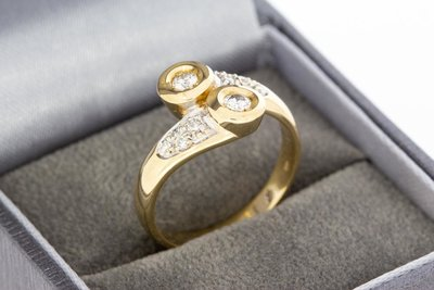 14 Karaat geelgouden Slagring gezet met Diamant- 0.46 crt