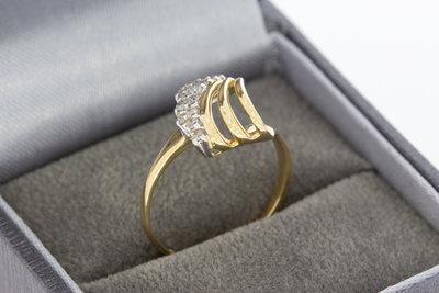 14 karaat geelgouden Fantasiering gezet met Diamant