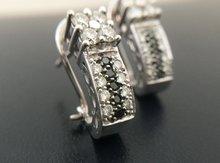 18-karaat-witgouden-clip-oorstekers-gezet-met-0.60-crt-(gedeeltelijk-zwarte)-briljantgeslepen-diamant-H-VSI