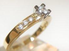 14 karaat bicolor gouden Solitair ring met Diamant (0.3 crt)