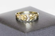 14 Karaat bicolor gouden hartjes ring gezet met Zirkonia
