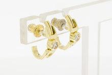 14 K gouden oorstekers met briljant geslepen Diamant