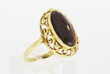 14 K gouden ring gezet met Granaat