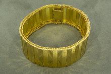 18 karaat brede plaatjes geelgouden armband- 19,5 cm