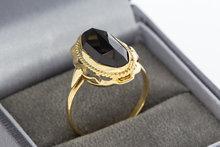 14 karaat geelgouden ring met facet geslepen Granaat